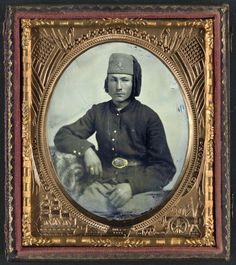 Unidentified soldier of Company F, 34th Ohio Infantry Regiment or Piatt's Zouaves.  Note: As with many ambrotypes and tintypes, the image is a reverse image.  Liljenquist Family Collection of Civil War Photographs; Ambrotype/Tintype photograph filing series; Library of Congress Prints and Photographs Division.