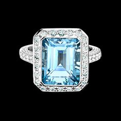 Trap cut aquamarine 5.24cts and diamond cluster ring in 18ct white gold
