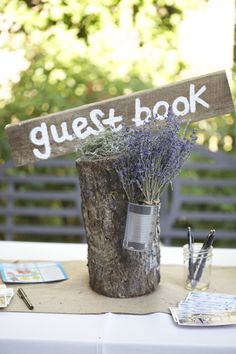 Log, lavender, and wedding guestbook.