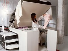 Space-Saving Bed That Gives You a Walk-in Closet. I'd actually have a wheeled stool to sit on so I could see everything a little easier.