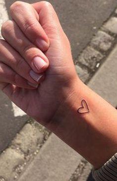tattoos-little-woman-tattoo-on-the-heart-doll-very-beautiful diy tattoo ideas tatoo femi Dainty Tattoos, Pretty Tattoos, Mini Tattoos, Sexy Tattoos, Cute Tattoos, Sleeve Tattoos, Tatoos, Cute Small Tattoos, Cool Little Tattoos