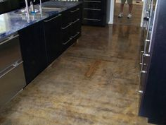 Stained concrete floor in kitchen