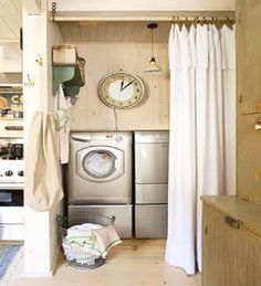 Laundry Nook in a Kitchen. I like the curtain for a door and I like the walls, ceilings, and floors.
