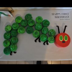 Hungry caterpillar cake! (kind of like this best...maybe the face is the smash cake??)