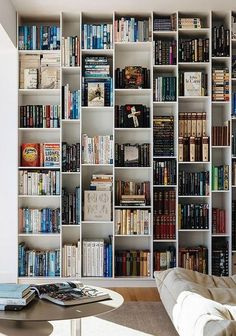 25 Modern Home Library Design Ideas That Stand Out A gorgeous modern home with a large asymmetrical bookcase that makes a statement and a comfy bean b Interior Architecture, Interior Design, Interior Styling, 1970s Architecture, Book Wall, Home Libraries, Built In Bookcase, Bookcase Styling, Library Design