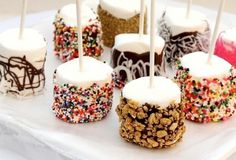 Marshmallow Fun Pops  Dip them, dunk them, coat them, eat them! How fun would these be to make? You can get creative with all sorts of fun candy coatings and toppings, and even make them to match your theme.