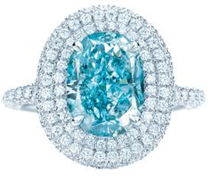 Tiffany Anniversary ring with an oval fancy vivid greenish blue diamond, 2.51 carats, in a diamond and platinum setting.  Via The Jewellery Editor.