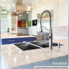 We are so excited to have our Caliber Topmount Sink featured in this gorgeous open kitchen 🤩 This stunning cohesive color palette 🎨 brings this modern white kitchen to life. Featuring a unique blue kitchen island and a custom Havens Stainless Range Hood, the design has the perfect combination of style and functionality. FACEBOOK/PIN HASHTAG #rangehoods #stainlesssteelkitchen #whitekitchendesign #kitchencolor #highendinteriors #luxuryresidential Stainless Farmhouse Sink, Copper Farmhouse Sinks, Stainless Steel Kitchen, Copper Sinks, Stainless Steel Cleaner, Stainless Steel Types, Stainless Steel Sinks, Kitchen And Bath Gallery, Havens Kitchen
