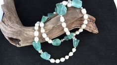 So gorgeous!!!...Beautiful Freshwater Pearls Enhanced with Frosted Icey Blue Quartz Chunks with Silver Beads.  via Etsy.