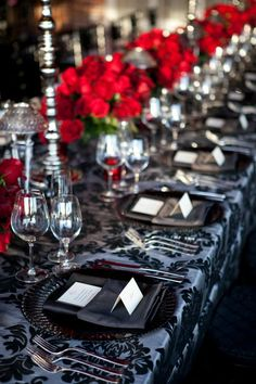 damask reception linens, wedding black red and white theme. Black and Red, White. Roses. High and Low centerpieces.