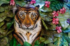"""""""Britain's largest cake containing life sized leopards, peacocks & an elephant unveiled at the Cake & Bake show"""" -- Incredible! """"...created by CakeBomb – the all-edible walk-in jungle cake took over 6,000 hours to create & contains more than 1,700 flowers & thousands of leaves as well as edible, life-sized leopards, peacocks, an elephant & even an alligator. 534kg of icing, 750kg of cake, 40kg of chocolate went into the making of the jungle."""" More photos at click-through."""