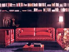 red leather sofa and dark purple wall paint, deep purple color with brownish and grayish tones