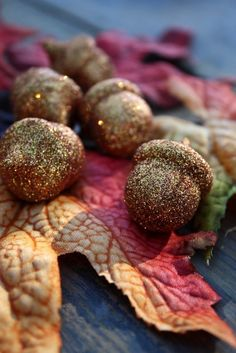 Idea: coat acorns from craft store with spray adhesive and roll in gold glitter!