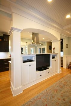 Kitchen/Family room divider -- hate the tv, LOVE the divider -- maybe books instead