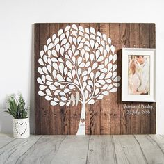 This beautiful tree guest book is a perfect signature tree for your alternative wedding guest book. With 125 tree awaiting to be signed by your guests; your printed and mounted wooden sign proudly holds a picture frame that will hold your most precious photo. • 16 x 20 inches / 9mm