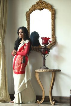 red and white sari with elegance and a tinge of tradition--beautiful, go to blossomboxjewelry.com for accessories