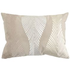 """18x13 $20 You had us at """"intricate needlework on a metallic woven fabric."""" But the beautiful Embroidered Wave Pillow is also surprisingly versatile. Its soft colors play well in a range of settings, and the slim, oblong shape sits prettily on chairs and benches. Catch it soon."""