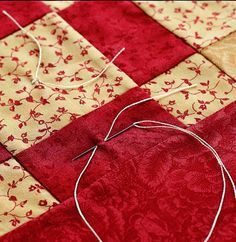 Tying, or tufting, is a quick alternative to hand- or machine-quilting. Tied quilts have a puffier look than those that are quilted. Here are some tips from All People Quilt in how to tie a quilt. Quilting For Beginners, Quilting Tips, Quilting Tutorials, Machine Quilting, Quilting Projects, Sewing Projects, Crazy Quilting, Sewing Tips, Sewing Tutorials