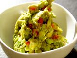 Great Guacamole recipe.  My husband does not like guacamole but he loves this recipe.  He likes it with more tomatoes and garlic. Adjust for your own taste.