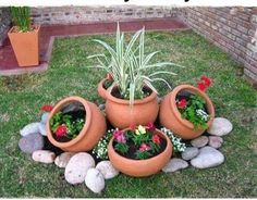 Flower pots and rocks make a cute addition to your outside landscaping. diy garden landscaping 15 One-Day Garden Projects Anyone Can Do Garden Yard Ideas, Lawn And Garden, Garden Edging, Simple Backyard Ideas, Creative Garden Ideas, Front Yard Ideas, Diy Garden Ideas On A Budget, Cheap Garden Ideas, Small Garden Ideas Low Maintenance