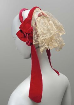 Woman's cap about 1860 DIMENSIONS Overall: 22.9 x 27.9 x 10.2 cm (9 x 11 x 4 in.) 3 wire bands covered with red velvet ribbon, two deep ruffles of machine made lace sewn to bans across back, velvet ribbon bows and ties at sides