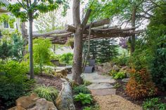 A tree pergola provides shade on hot summer days while providing architectural interest to the outdoor living space.