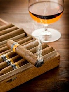 cigars in box with drink