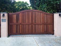 driveway gate made from Redwood. Intercom, gate opener