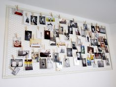 Easy to make: Chicken wire in frame, make it as small or big as you wish. Use clothespins to hang cards.