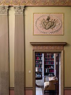 A view from the Hall to the Library at Basildon Park, Berkshire. The Neo-classical plasterwork decoration of the Hall shows the Adam influence on John Carr of York who designed the house in the late eighteenth century.
