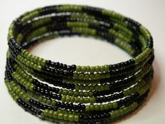 Green and black seed beads in this multi-layered memory wire bracelet.