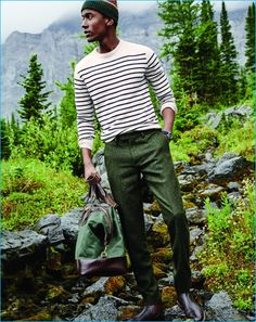 Nail that dapper look with a white striped crew-neck sweater and dark green wool trousers. Tap into some David Gandy dapperness and complete your look with oxblood leather chelsea boots. Shop this look on Lookastic: https://lookastic.com/men/looks/crew-neck-sweater-dress-pants-chelsea-boots/23222 — Dark Green Horizontal Striped Beanie — White Horizontal Striped Crew-neck Sweater — Dark Green Wool Dress Pants — Green Canvas Holdall — Burgundy Leather Chelsea Boots