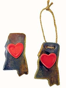 My Hearts in Mississippi Ornament or Magnet  Price: $13.00  Give a memory of Mississippi with this J.R. Webb creation.   This 4 inch handmade pottery creation is perfect for decorating or for the refrigerator to remind them that their heart is in Mississippi.