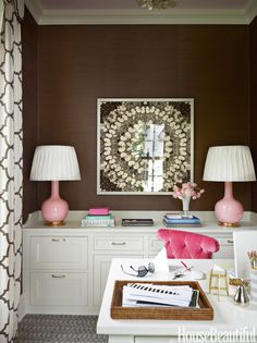 In the wife's office in a Greenwich, Connecticut, house designed by Ashley Whittaker, pink lamps by Christopher Spitzmiller stand out against brown grass cloth by Winfield Thybony. - HouseBeautiful.com