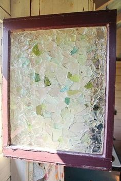 Sea glass privacy window. Use glass adhesive to cover the window and use clear floral-setting resin to fill in gaps.