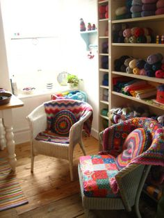 There's something so bright, cozy, warm and wonderful about the corner of this women's craft room- it reflects the all the colors of her heart! <3