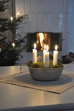 Easy DIY Advent wreath centerpiece - simple: old metal bowl, fill with beans or earth, cover with fake or real moss, insert candles (use non-flammable materials or ensure moss is well dampened, watch closely when lit)