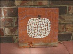 Pin for Later: Nothing Seedy: 11 Simple Pumpkin Seed Projects Pumpkin Seed Painting