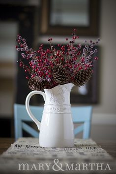 Add berries and pine cones to our Queen Anne's Lace Pitcher for a stunning centerpiece. http://www.mymaryandmartha.com/LaueaHoward