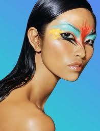 dramatic colorful bird feather eye make-up