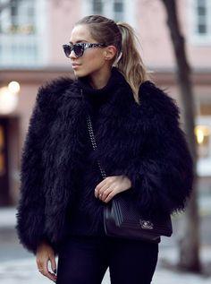 Kenza Zouiten is wearing a black fluffy faux fur jacket from Pello Bello