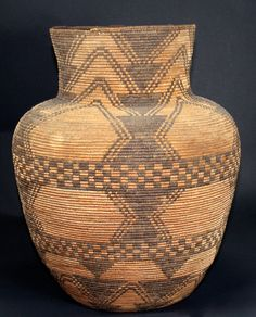 Pictured here is an olla made by an Apache tribe. An olla is a ceramic or wicker storage container, that is typically un-glazed. They were used to store food or beads.
