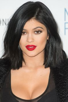 KYLIE Classic red lips and shimmery gold eyes are a winning pair every time.