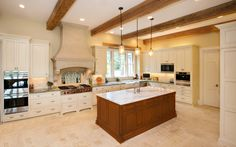 This kitchen was designed by Kitchen & Bath Cottage in a home built by Terry Elston, Builder. The kitchen features Wood-Mode cabinetry, Wolf, Sub-Zero and Miele appliances as well as stone flooring. Visit us at www.kbcottage.com!