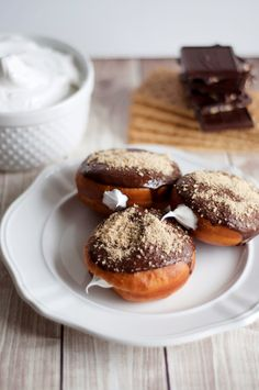 S'more donuts with marshmallow cream, chocolate ganache and salted graham cracker crumb.