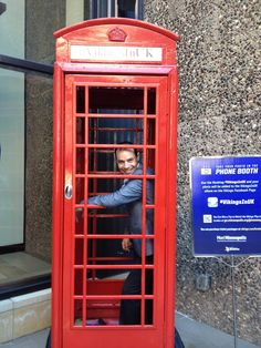 Hotel Ivy's General Manager poses with the red phone booth while it visits the Porter & Frye patio! #VikingsInUK | Minneapolis, Minnesota