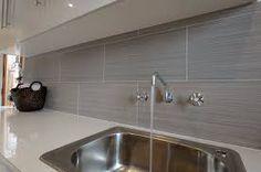 Image result for dark grey large tile kitchen splashback