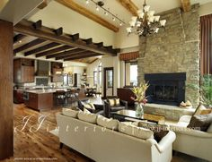 Living room space - the different wood flowing between the beams and floor with the stone do the fire place. Description from pinterest.com. I searched for this on bing.com/images