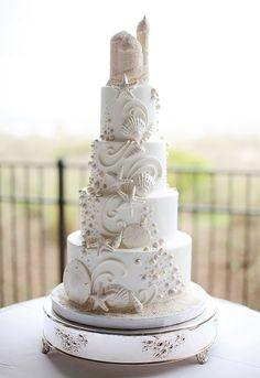 gorgeous beach sand castle wedding cake... just wow