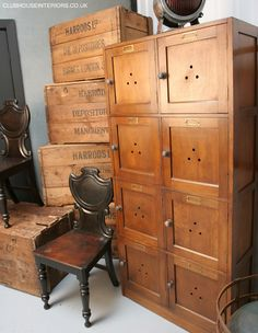 a lovely collection of Original Harrods Wooden Crates, a Antique Wooden Locker and a pair of carved dark wood Vintage Chairs. Restored Furni...